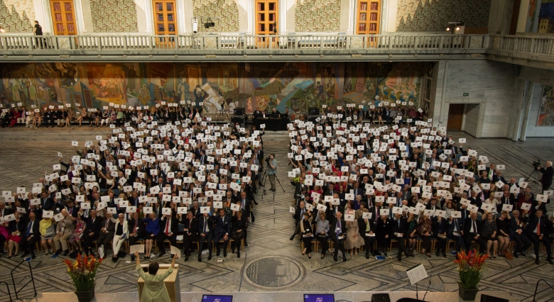 All the attendees of the Awards Ceremony held at Oslo City Hall on 11 June 2015, showing their support to UNESCO's campaign #Unite4Heritage. Photo: Felix Quaedvlieg