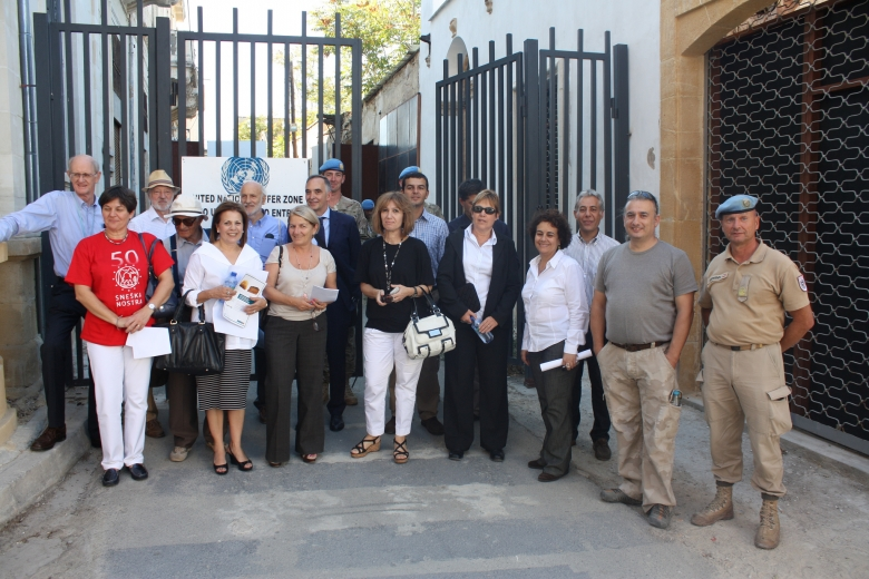 Representatives from European institutions and delegates from the Greek Cypriot and Turkish Cypriot communities entering the Nicosia buffer zone from the Ledras-Lokmaci crossing. Photo: Courtesy of municipality of Nicosia
